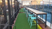 Outdoor seating, which will be awesome once it warms up. There are also outlets on the top of the table you can use.